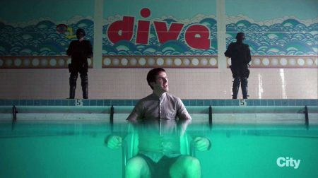 in a few seconds, David will actually follow the wall inscription's imperative and take a dive to save his life. (Also note the optical distortion-slash-illusion created by the underwater-part of the shot that has David's lower body magnified, which could be read as visual metaphorization of David's schizophrenia – two personas in one body.