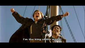 Left to right: Jack Dawson (Leonardo DiCaprio) and his traveling companion, Fabrizio (Danny Nucci), standing on the ship's bow in Titanic